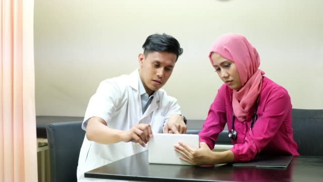 doctors consult each other - malaysian ethnicity stock videos & royalty-free footage