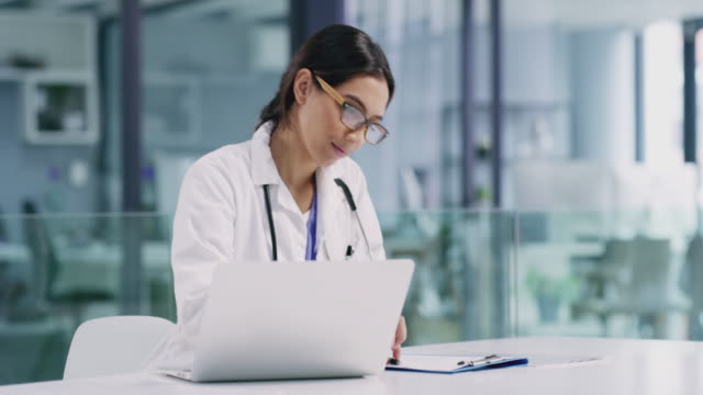 a doctor's day is filled with many duties - medical record stock videos & royalty-free footage
