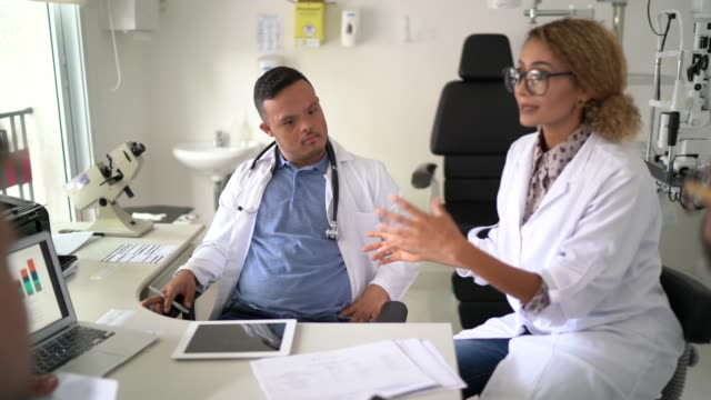 doctors discusses something during conference / meeting - gender equality stock videos & royalty-free footage