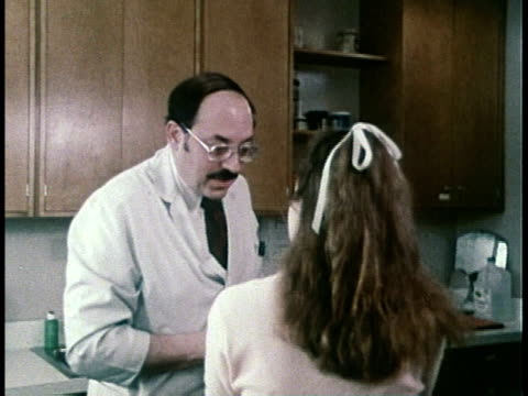 1979 MONTAGE doctors examining patients / United States