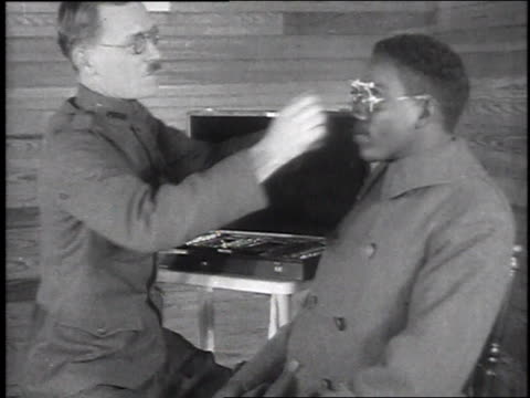 stockvideo's en b-roll-footage met montage doctors examining soldier patients' eyes / camp sherman chillicothe ohio united states - chillicothe