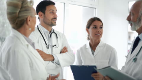 doctors in a meeting. - medical clinic stock videos & royalty-free footage