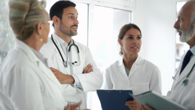 doctors in a meeting. - clinica medica video stock e b–roll