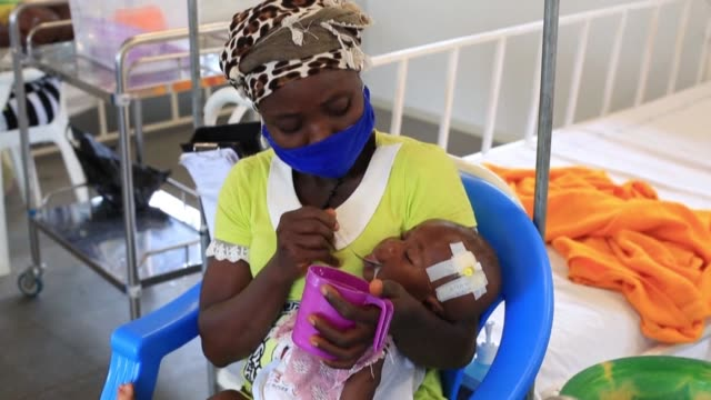 doctors in sierra leone warn that infant death rates could go up as parents avoid bringing their sick babies to hospitals for fear of contracting... - contracting stock videos & royalty-free footage