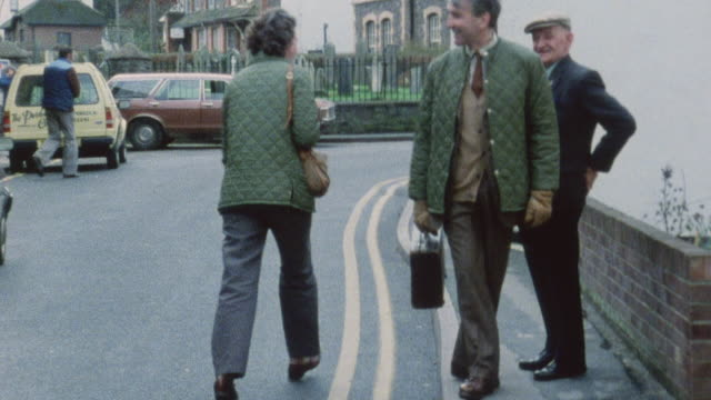 stockvideo's en b-roll-footage met 1983 montage doctors iona heath and keith lister interacting with their patients of kentish town / london, england - kentish town