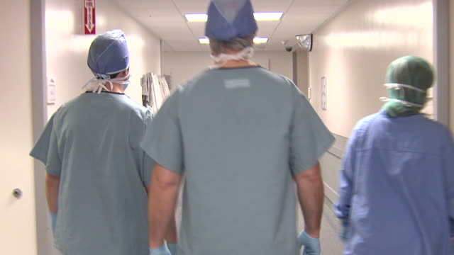 doctors leaving after a tough day - operating theatre stock videos & royalty-free footage