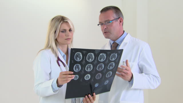 doctors looking at medical scan - scientific imaging technique stock videos & royalty-free footage