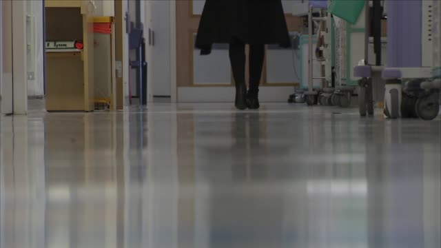 doctors, nurses and patients in hospital corridor - blurred motion stock videos & royalty-free footage