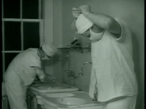 stockvideo's en b-roll-footage met dramatization doctors nurses technicians prepping patient strapping down anesthesia being administered doctors scrubbing hand arms young dr gibson... - chirurg
