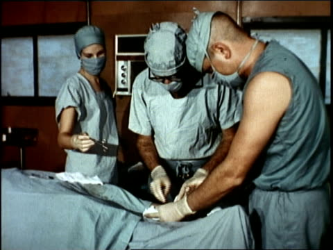 doctors operating on patient / vietnam - マッシュポテト点の映像素材/bロール