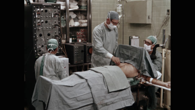 doctors performing brain surgery in operating room - operation stock videos & royalty-free footage
