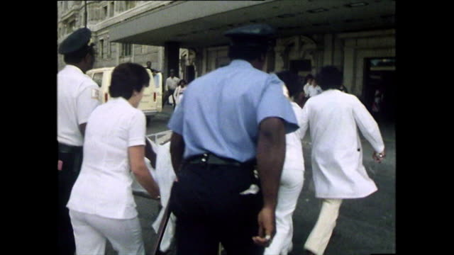 doctors push patient on trolley into emergency room; 1979 - running stock videos & royalty-free footage