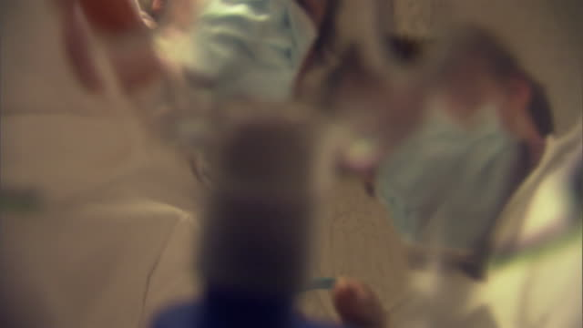 pov cu la doctors putting on oxygen mask on patient as they move hospital gurney through corridor / burlington, vermont, usa - korridor stock-videos und b-roll-filmmaterial