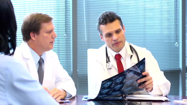 doctors review and discuss radiology slides - microscope slide stock videos and b-roll footage