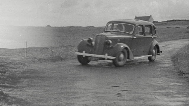 1943 montage doctors traveling along rural country roads by automobile and arriving at remote homestead for house call / scotland, united kingdom - house call stock videos & royalty-free footage