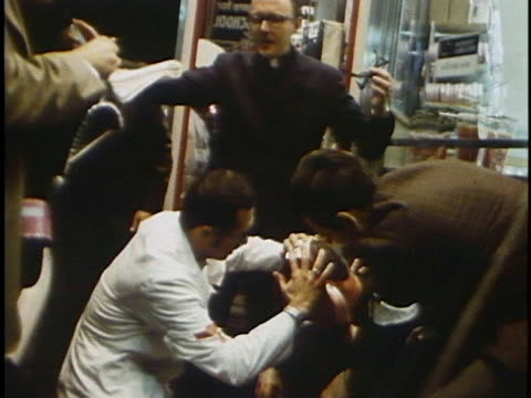 doctors treat a wounded protester after a police beating outside of lincoln park during the 1968 democratic national convention. - organized group stock videos & royalty-free footage