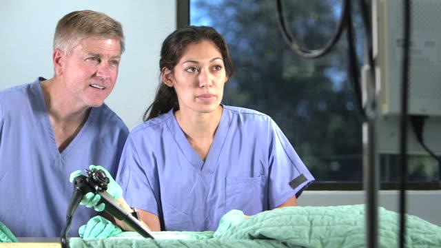 doctors using endoscope - pacific islander doctor stock videos & royalty-free footage