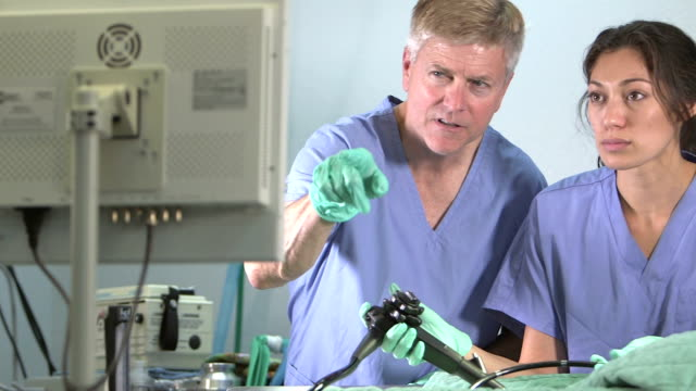 doctors using endoscope - endoscope stock videos & royalty-free footage