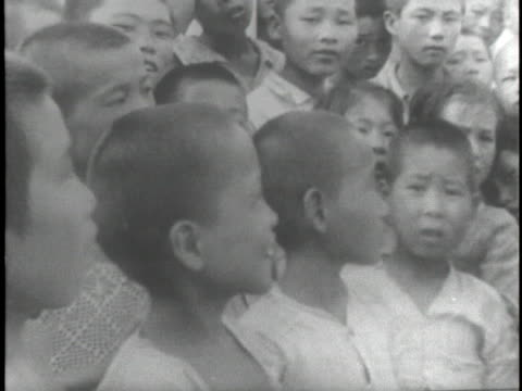 doctors visit with refugees at the korean national red cross headquarters in taegu during the korean war. - korean war stock videos & royalty-free footage