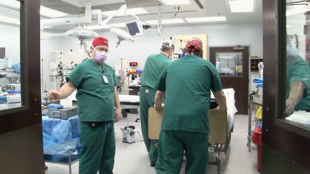 WS Doctors walking into operation room  /  Little Rock, Arkansas, USA