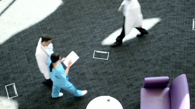 doctors walking, view from above - entrance hall stock videos & royalty-free footage