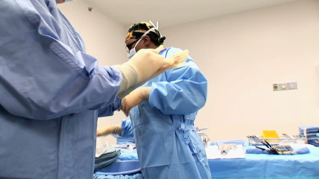 stockvideo's en b-roll-footage met ms doctors wearing surgical gloves  /  little rock, arkansas, us - protective workwear