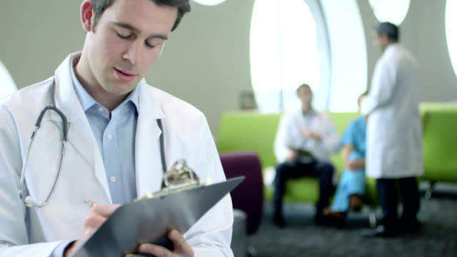 Doctors with clipboard