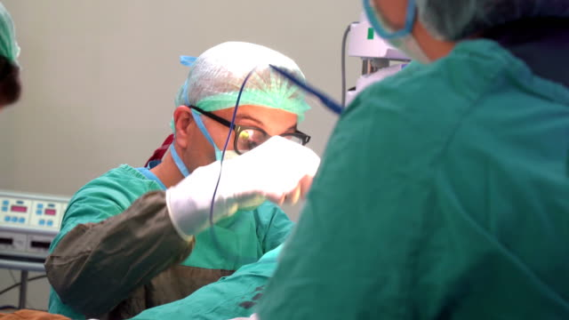 doctors working on patient in heart sugery - anaesthetist stock videos & royalty-free footage