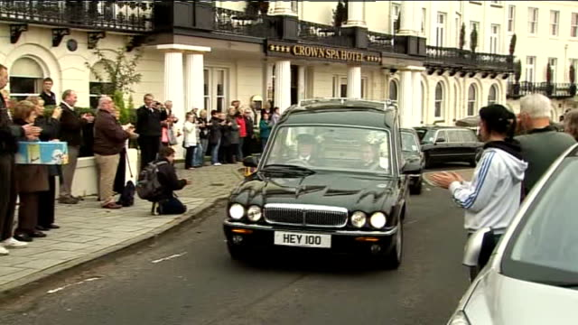 stockvideo's en b-roll-footage met documentary alleges sir jimmy savile sexually abused teenage girls lib / scarborough ext hearse carrying coffin of jimmy savile along outside crown... - scarborough engeland