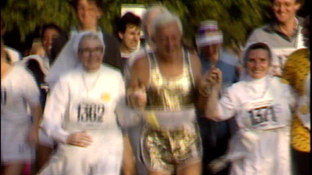 documentary alleges sir jimmy savile sexually abused teenage girls; 138743 / tx 28.9.1986 london: hyde park: ext savile taking part in fun-run with... - running shorts stock videos & royalty-free footage