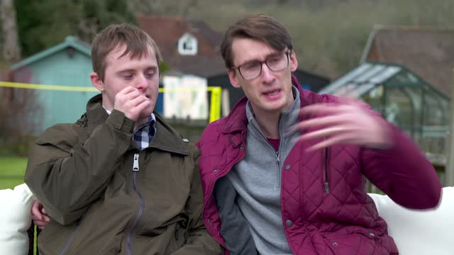 documentary exploring what it means to have a sibling with down's syndrome; england: ext nicholas bourne interview alongside his brother alex bourne... - news not politics video stock e b–roll