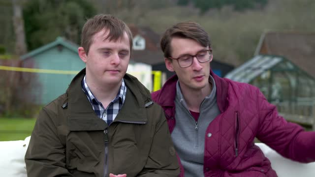 documentary exploring what it means to have a sibling with down's syndrome; england: ext reporter asking question sot nicholas bourne interview... - news not politics video stock e b–roll
