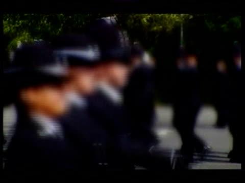 vídeos y material grabado en eventos de stock de documentary on police recruits; lib ext police recruits marching during training - military recruit