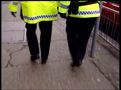bbc documentary on police recruits lib track behind two police officers walking the beat - military recruit stock videos and b-roll footage
