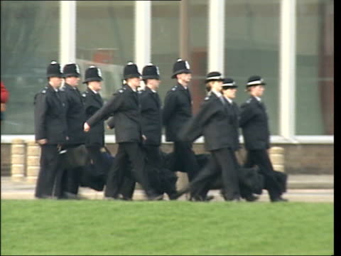 bbc documentary on police recruits lib hendon police marching along carrying bags police at hendon police training centre - military recruit stock videos and b-roll footage