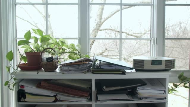 cu documents on shelves in home office, scarborough, new york, usa - 書斎点の映像素材/bロール
