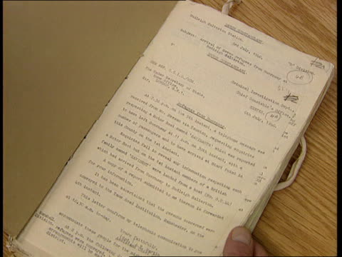 vídeos de stock, filmes e b-roll de documents released detailing germany's war-time occupation of the channel islands; itn england: london cms notebook detailing nazi atrocities on the... - ilhas channel