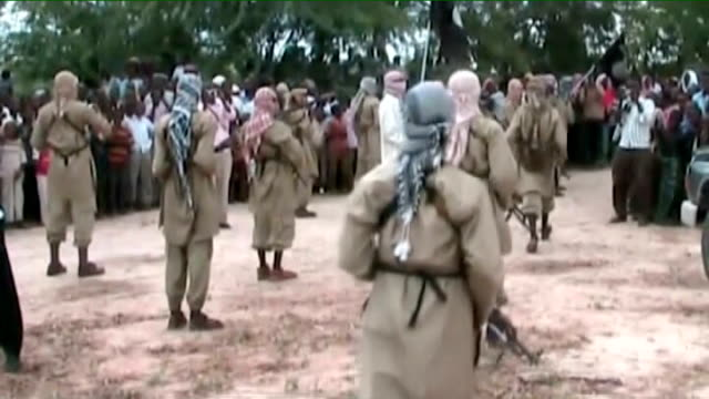 documents reveal osama bin laden plot to assassinate barack obama t02110911 mogadishu ext various shots of armed al shabaab militants in streets - al qaida stock videos & royalty-free footage