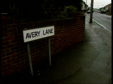 hants nr gosport avery lane where car was recovered pan to road sign road pan to newsagents outside which admiral's car containing confidential staff... - gosport stock videos & royalty-free footage