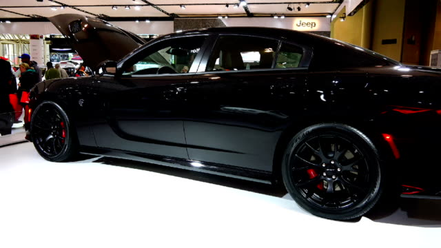 dodge charger srt in the canadian international autoshow which is canada's largest automotive show held annually at the metro toronto convention... - strategia di vendita video stock e b–roll