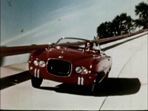 1956 ws ts rear pov 1954 dodge firearrow concept car on banked track / usa - konzeptauto stock-videos und b-roll-filmmaterial