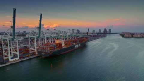stockvideo's en b-roll-footage met aerial dodge island, fl and fishermans channel at sunset - economie