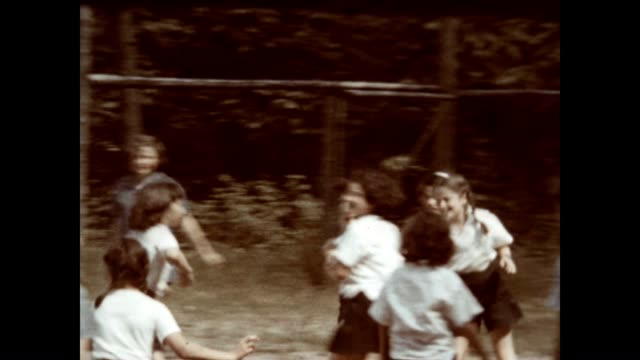 dodgeball at a girls camp on lake schroon in the adirondacks in the 1940's - summer camp helper stock videos & royalty-free footage