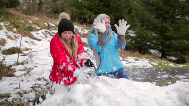 Dodging Snowballs with her Colleague