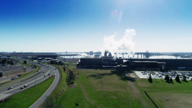 does the industry mean pollution? the plant on the shore of lake superior, one of the great lakes, minnesota. aerial drone video with the ascending camera motion. - great lakes stock videos & royalty-free footage