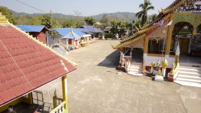 tl. dog at temple in houay xai, laos.  - spoonfilm stock-videos und b-roll-filmmaterial