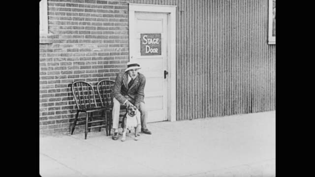1920 a dog chases a man through the streets while men (fatty arbuckle and buster keaton) try to catch it with large nets - fatty arbuckle stock videos and b-roll footage