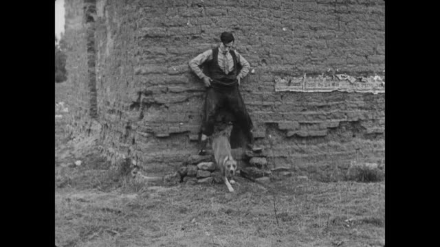 1920 dog chases man (buster keaton) in abandoned building while friend (joe roberts) gets help - chasing stock videos & royalty-free footage