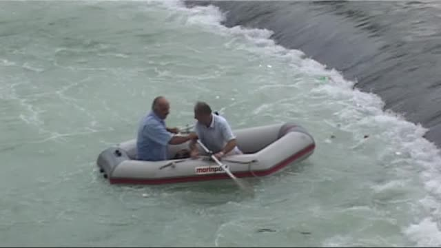 a dog fell into the water is being rescued by two men on a inflatable boat on the kelkit river in tokat turkey on august 17 2016 - befreiung stock-videos und b-roll-filmmaterial