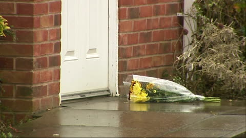 dog that killed baby girl in daventry was illegal breed; england: northamptonshire: daventry: ext bunch of flowers on doorstep of house northampton:... - northampton stock-videos und b-roll-filmmaterial